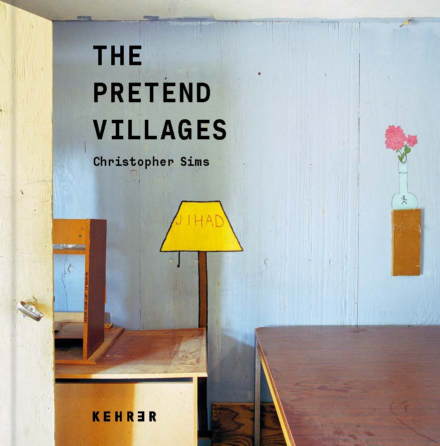 "A cover for the book that shows a lamp drawn onto a wall and the title ""The Pretend Villages"""