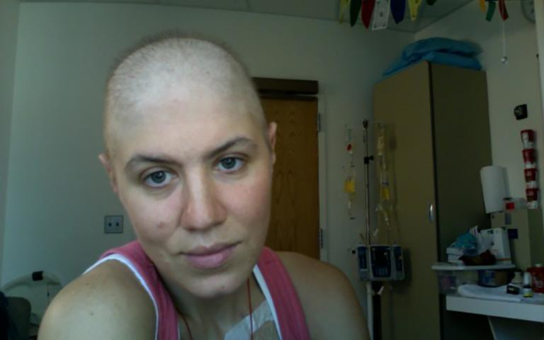 Photo: A young woman getting chemotherapy treatments, 2007. Courtesy of Ibby Caputo.