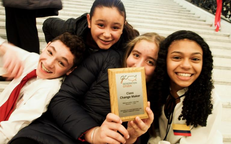 Photo: Eighth-grade students at Pyne Arts Magnet School in Lowell, Massachusetts, with their award at Civics Day in Boston.