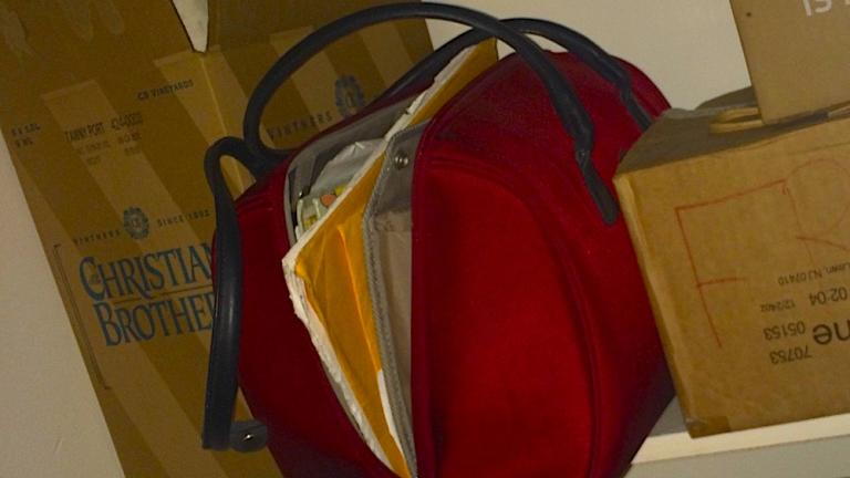A photograph of a red suitcase