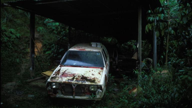 A disused car lies in a shed behind a house in the remote village of Kampung Kipouvo, Penampang district