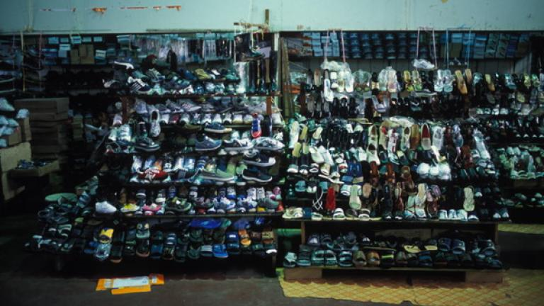 Shoes line the racks of a store in Kota Kinabalu.