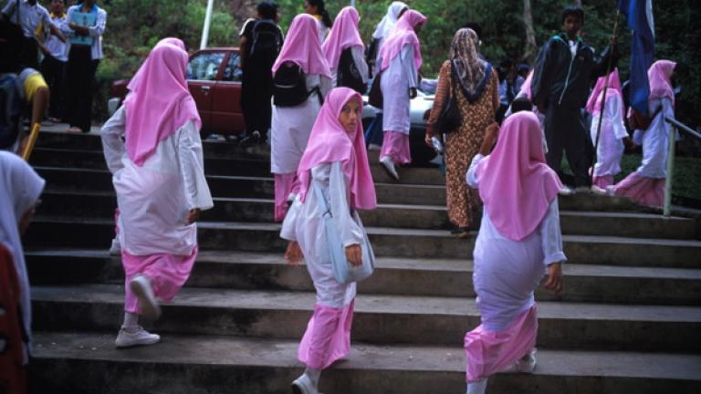 A group of Muslim schoolgirls leave a school sporting event in Donggongon, the main town in the Penampang district, outside of Kota Kinabalu.   The Malaysian government has a strong affirmative action policy aimed at promoting Muslim Malays within society, particularly in the area of education.