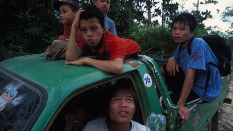 A group of boys from Tongod wait in a car to return to their village after spending a day picnicking at a nearby river.   Aside from rubber tapping or plantation work, job opportunities in rural communities are scarce. Young people have an abundance of spare time, and alcohol abuse is not uncommon.