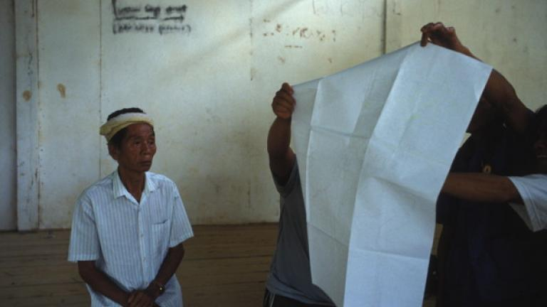 Community representatives from Pitas district in northern Sabah examine a PACOS map showing their lands and native title rights.