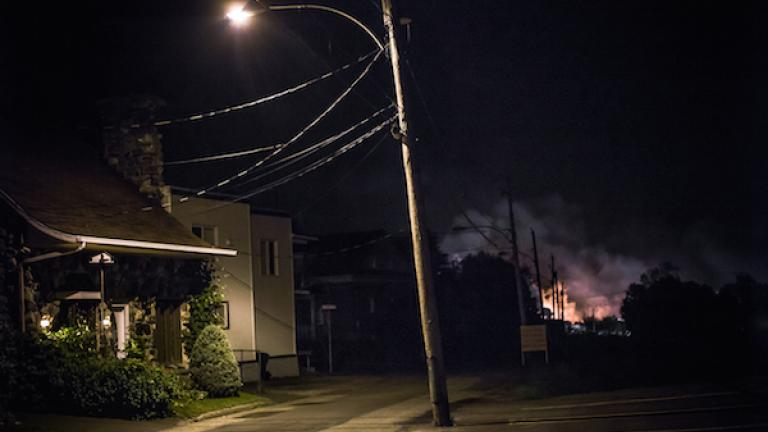 """Twenty-one hours after the derailment, July 6, 2013. From """"Post Mégantic"""" by Michel Huneault, winner of the 2015 Lange-Taylor Prize."""