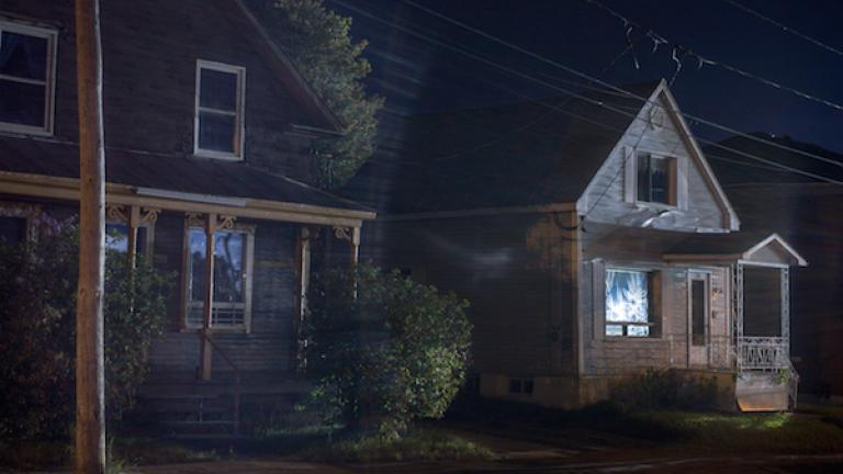 """Houses lit by spotlights from the Red Zone, August 2013. From """"Post Mégantic"""" by Michel Huneault, winner of the 2015 Lange-Taylor Prize."""