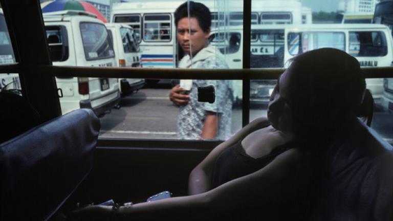 A woman rests in a minivan in Kota Kinabalu, Sabah's capital city.