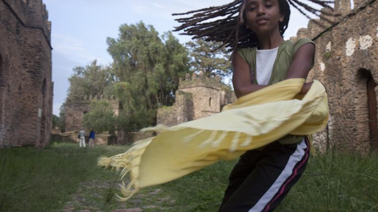 Tsehaye runs through the grounds of Emperor Fasilides Castle in Gondar.