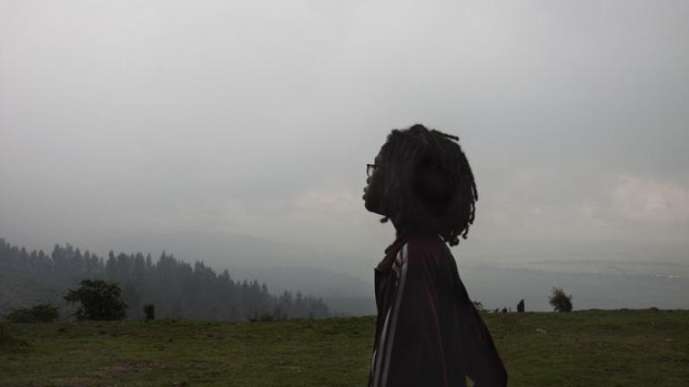 Zoe walks along a road on Mount Entoto overlooking Addis Ababa.