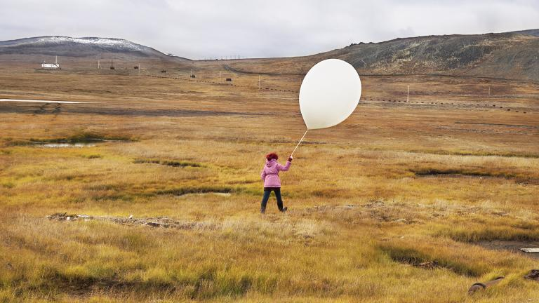Tanya is happy to finally get a chance to run around tundra with a weather balloon at Polar meteorological station.