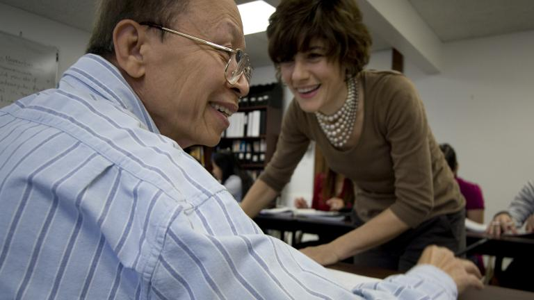 During class, Trung jokes with his English for Speakers of Other Languages (ESOL) instructor, Manuela Arundel. Trung left Vietnam after fighting with the South Vietnamese during the war.