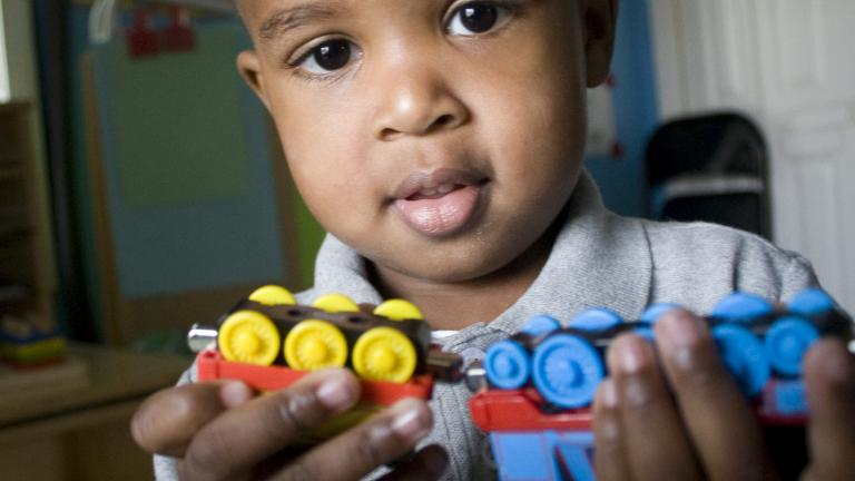 A two-year-old boy attends one of College Bound Dorchester's home-based early education programs at Sabina's day care. Sabina operates a preschool out of her home in Mattapan, Massachusetts.