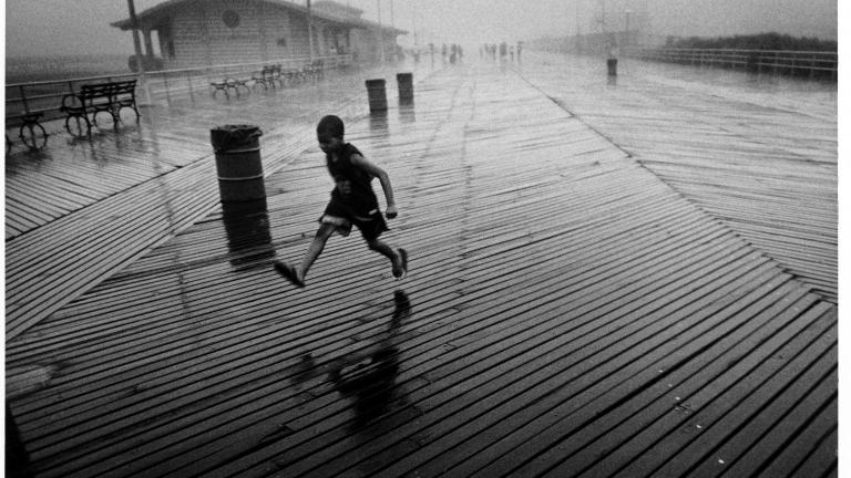 Running Boy in Rain, 2005. Photograph By Harvey Stein.