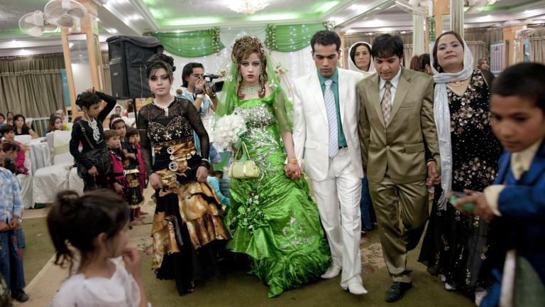 Amin Shaheen and his bride at a wedding hall in Kabul.