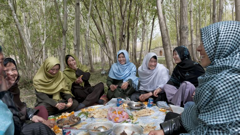 Young women, many of them studying to become teachers, relax in the Women's Garden of a park intended for families outside the city of Bamian.