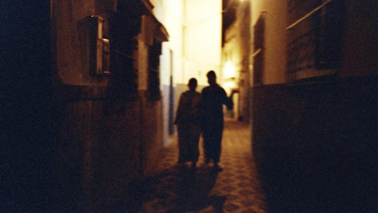 Khadija and Ghita walking through the old city, which has been gentrified by European homeowners, Morocco, 2008