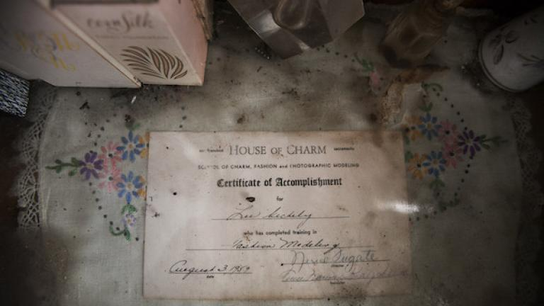 "Photograph from ""House of Charm"" by Jessica Eve Rattner, winner of the 2016 CDS Documentary Essay Prize in Photography. The 1959 graduation certificate from House of Charm—the San Francisco School of Charm, Fashion and Photographic Modeling—that Lee attended as a young woman, Berkeley, California, 2011."