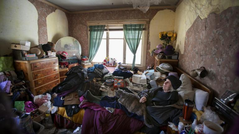 "Photograph from ""House of Charm"" by Jessica Eve Rattner, winner of the 2016 CDS Documentary Essay Prize in Photography. Lee's bedroom, Berkeley, California, 2013. When it became too cluttered to be safe, Lee's son moved her into another room in the house."