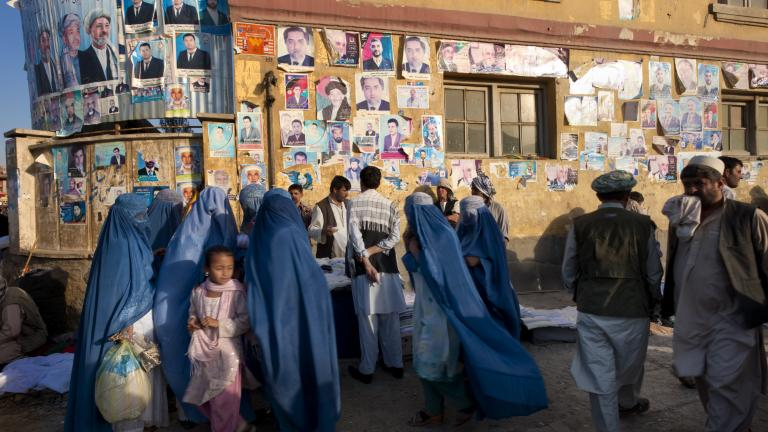 Election posters for Presidential elections and for members of the Provincial Council line the walls throughout the city in Kabul, Afghanistan, July 25, 2009. As Afghans gear up to vote in presidential elections slated for August 20, the candidates are on the campaign trail.