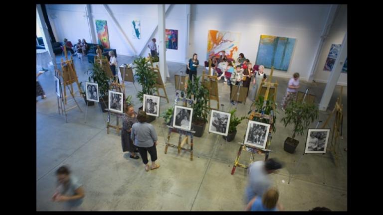 The portraits of all eighteen families who participated in the project were on display in the gallery at the Artists for Humanity EpiCenter. Photograph by Justin Ide.