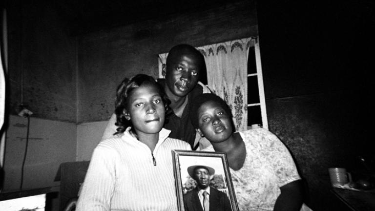 The one on the left side is my sister Chiedza; the one on the right side is my older sister, Tariro; the one in the middle is my brother, Harold; and the last one in the picture is my father. I took this picture so that I can have a memory when they are not around or alive. I was thinking, is the photo going to be ugly or not, and the people who I was taking the photo of were thinking the same as I was thinking. When I look at it now I think it is the best photo. I like it because almost everyone in our fam