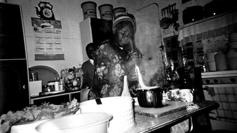 I like this picture of my mother cooking sadza because I enjoy her sadza. I took the picture so that I will always admire it when she is cooking sadza. This picture always gives me some memories of her when she is away. --Rangarirai Nhokwara, 19  Sadza, a corn meal paste, is the staple food of Zimbabwe.