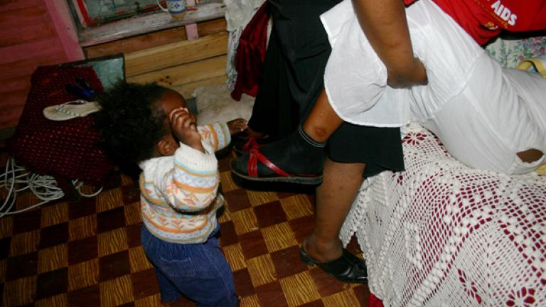 The incidence of violence and sexual assault against women in the township is high, one reason for the elevated rate of HIV infections. Though the women here are only play fighting, many children do witness violence against their loved ones.