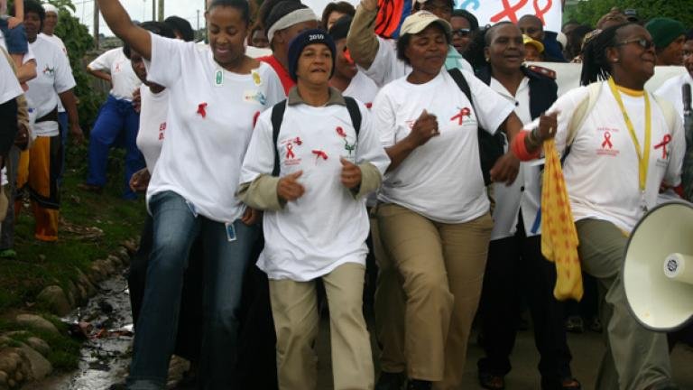 Beaty and Shaida, two leaders at MADaboutART, led the World AIDS Day march through the township, which began at the tavern and ended at the stadium.