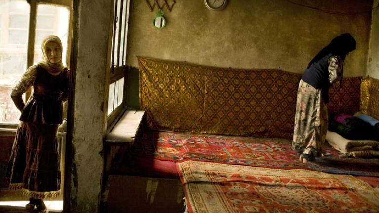 Afternoon prayers inside a Uighur home, Hotan, Xinjiang Uighur Autonomous Region, China, 2007
