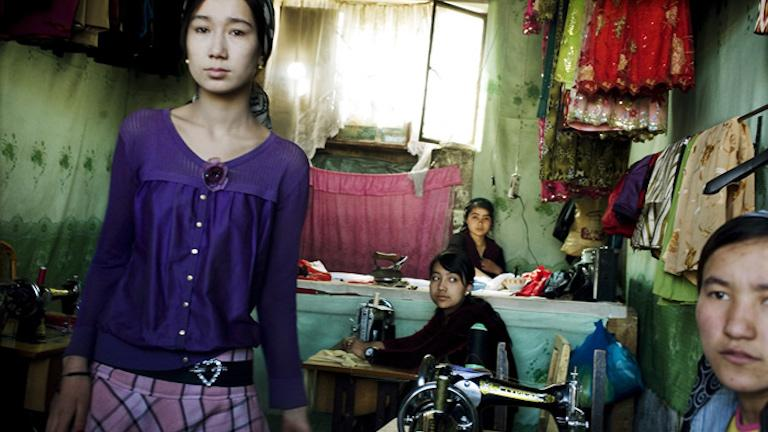 Young Uighur women work as seamstresses in the Old Town, Kashgar, Xinjiang Uighur Autonomous Region, China, 2007