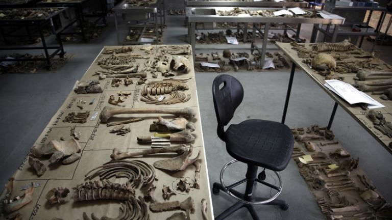 Re-association Center, Lukovac, Bosnia, 2006  Forensic experts are attempting to reconstruct full skeletons for burial from remains exhumed from the mass graves of men killed in Srebrenica in July 1995.