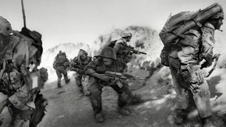 Canadian and Afghan National Army soldiers take fire from Taliban fighters in Kandahar province, southern Afghanistan, 2007