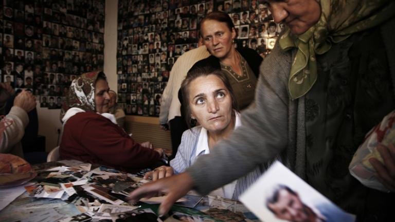 The Mothers of Srebrenica collating photographs, Tuzla, Bosnia, 2006  This group of women is working to collect, copy, and file photographs of the estimated 8,000 men murdered in Srebrenica in 1995. The Mothers have been one of the most tenacious groups in seeking justice and remembrance for their family members, and photography plays a crucial role in their work.