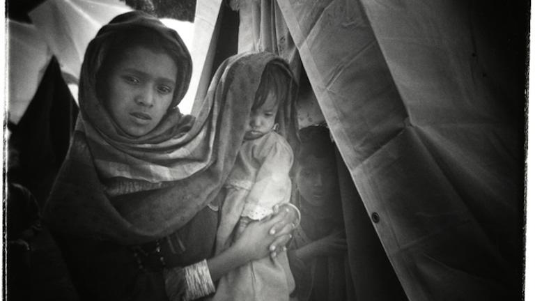 Survivors of a massive earthquake that killed 80,000 people and displaced 3.5 million survivors, IDP (internally displaced persons) camp, Muzaffarabad, Pakistan-administered Kashmir, 2005