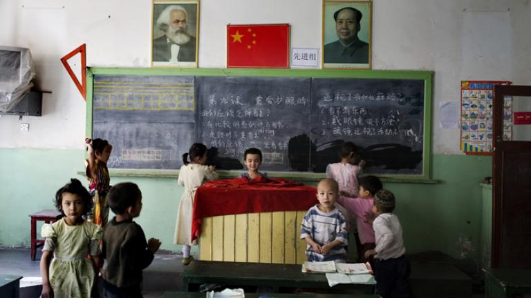 A mixed classroom of Han Chinese and Uighur students between classes, Kashgar, Xinjiang Uighur Autonomous Region, China, 2007