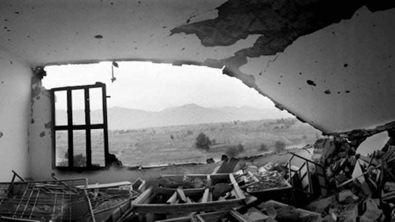 The mountains of Kunar province in eastern Afghanistan seen through the window of a destroyed building in Bajaur, in Pakistan's tribal areas, 2008