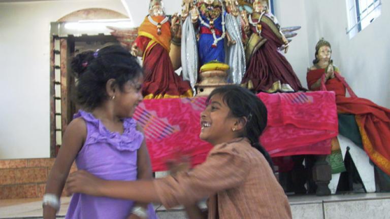 Two sisters play at a Hindi Temple, Baldwin, Kwa-Zulu Natal