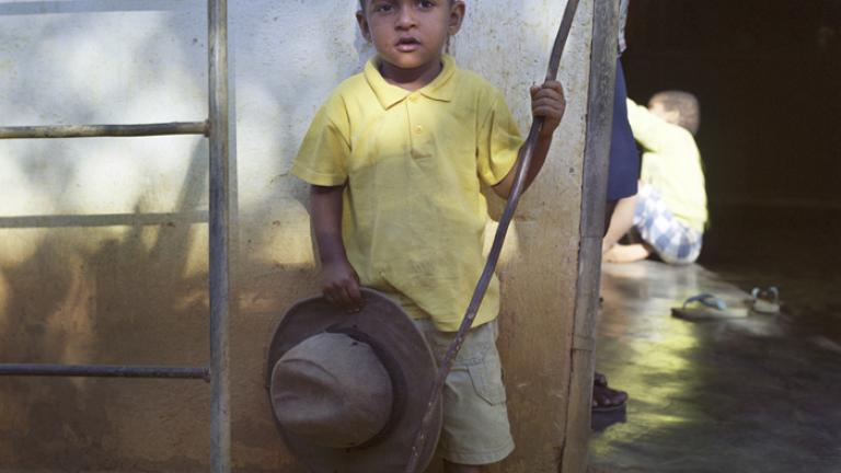 Dear Father, I am helping mother to take care of Grandpa's house. We are all doing well.--Diego