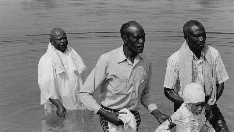Rev. Mitchell and Lisa Spear at a Mt. Zuma baptism in the Flint River, 1977. Photograph by Paul Kwilecki.