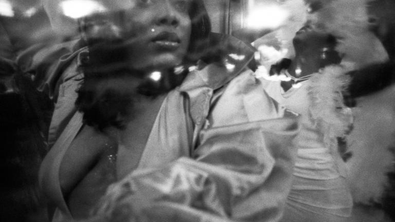 Jennifer looking through plastic as she walks the runway, YMCA, Brooklyn, 1999. Photograph by Gerard H. Gaskin.