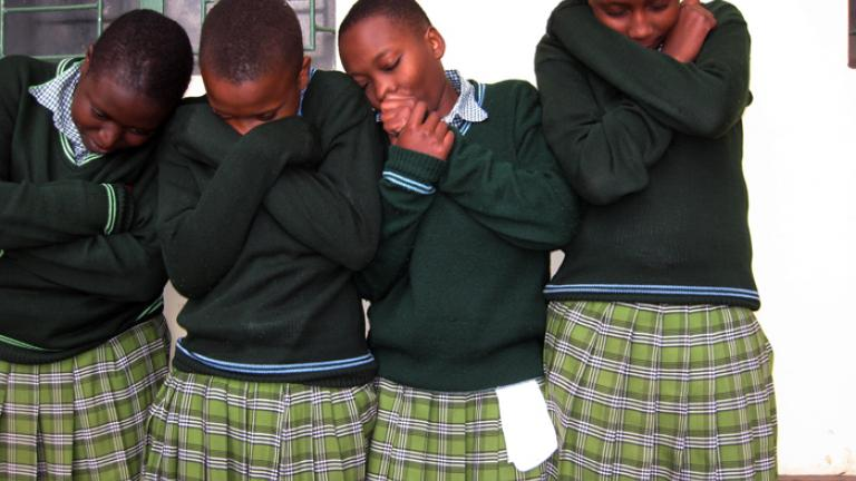 "At St. Joseph's Secondary School, an all-girls' high school, students represent ""hibernation"" in a study of homeostasis. From the Literacy Through Photography project in Arusha, Tanzania"