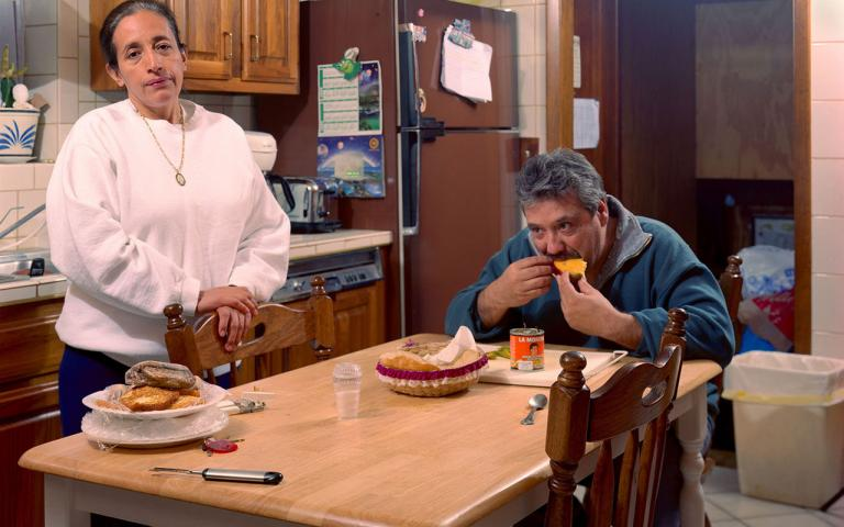 My mother and father at the dinner table, Berwyn, Illinois, United States of America, 2003. Photograph by Daniel Ramos, winner o