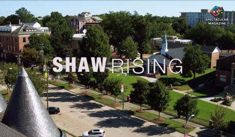 """A title card, an aerial shot of Shaw University with """"SHAW RISING"""" written over it."""