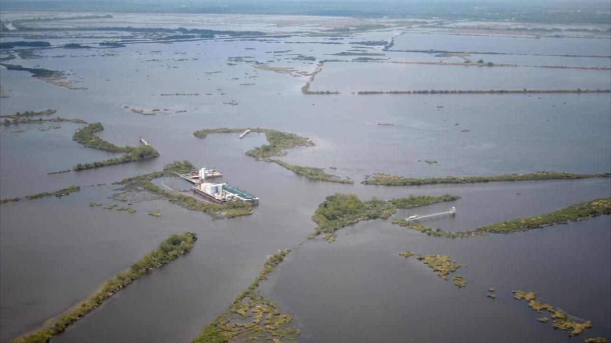Aerial view of land on the Louisiana coast gradually disappearing due to rising water