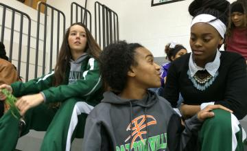 Pattonville High School basketball players watch the B-squad before a home game in Maryland Heights, Missouri.