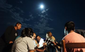 Photo: Jenna Horgan and migrant workers at a farm camp near Benson, North Carolina on July 28, 2015. Photo by Lucero Galván