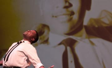 """Photo: Mike Wiley performing """"Dar He."""" Photo credit Arts Midwest"""