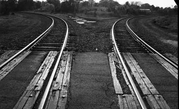 """Photo: The bend in the railroad tracks, about one block from Thelonious Monk's birthplace in Rocky Mount, North Carolina, that gave the neighborhood its name: """"Around The Y."""" Photograph by Sam Stephenson and Frank Hunter."""
