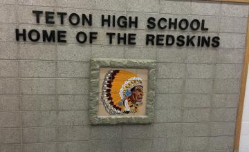Photo: Emblem in the main foyer at Teton High school in Driggs, Idaho. Photo by John Biewen.